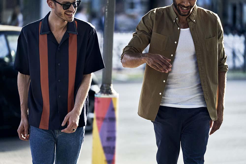Men talking and walking